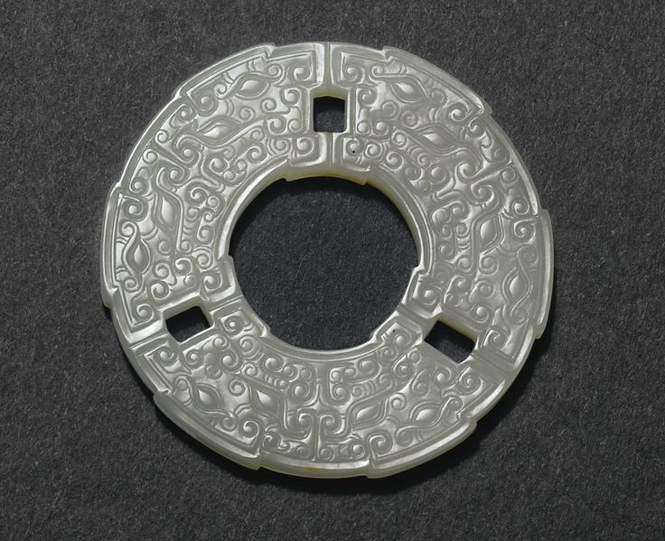 JP: A FINELY CARVED WHITE JADE DISC, BI, CHINA, QING DYNASTY, QIANLONG PERIOD (1736-1795)
