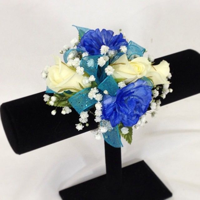 wedding flowers roses wrist corsage of white roses amp blue carnations accented 9637
