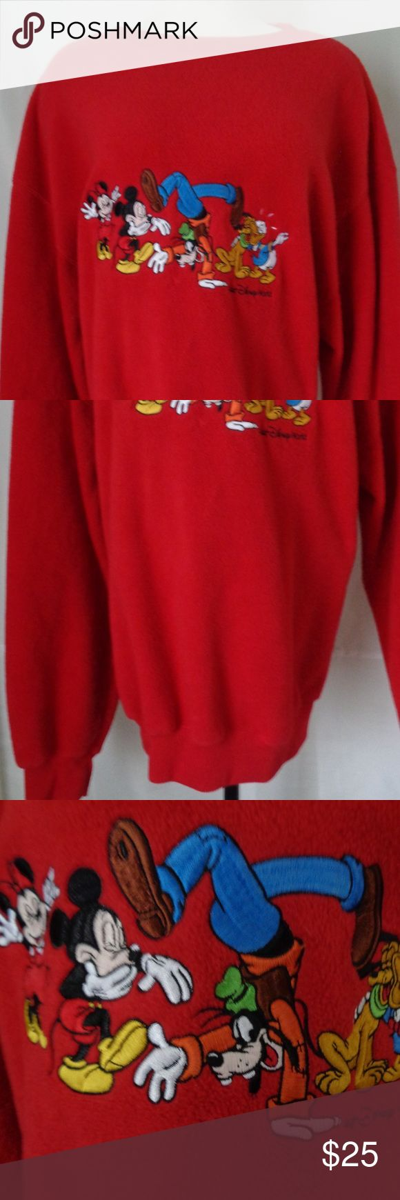 """Vintage Disney Red Fleece Sweatshirt XLarge  L13 Vintage Disney Red Fleece Sweatshirt   Embroidered Mickey Mouse , Minnie Mouse, Goofy,  Donald Duck and Pluto Characters  Walt Disney World tag and logo  Measurements  Armpit to Armpit 27 1/2"""" (flat)  Shoulder to Hem 30""""  Hem 20"""" (flat and unstretched)  Sleeve 26"""" (shoulder seam to cuff edge )   Excellent Pre Owned Condition. See description for measurements and pictures with zoom  L13 Disney Tops Sweatshirts & Hoodies"""