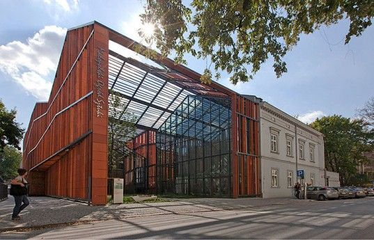 The new Małopolska Garden of Arts in Krakow, designed by Ingarden & Ewy Architects,  is a sprawling new cultural center constructed inside the skeleton of a Victorian horse-riding arena.