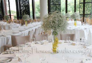 baby's breath gyp arrangement with orchids in glass vase wedding table deco arrangement