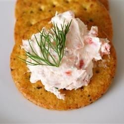 A delicious and easy spread that always gets many compliments. Serve it with somewhat bland crackers to taste the smoked salmon. You can add some chopped capers for more flavor, if needed. I usually serve this on a nice plate and put the spread in a mold before serving.
