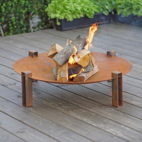 """Curonian Alna Solid Carbon Steel Wood Burning Fire Pit is the perfect addition to any backyard patio or deck. This modern looking, rustic design fire pit is made from the highest quality solid carbon steel. Sturdy construction with a large 31.5"""" diameter fire bowl. This product is very durable and will last long years. The carbon steel used in manufacturing this fire pit will develop a nice patina over time."""