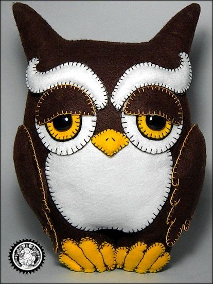 Cute owl pillow or wall-hanging.
