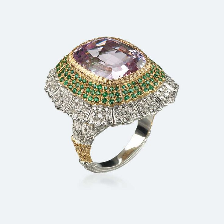 Cocktail ring with orchid pink kunzite surrounded by a row of emeralds and another of diamonds set in yellow and white gold. A bearer of light par excellence, kunzite instils joy and warmth even into the coldest hearts, which, observing its bright, romantic tones running from pink to purple, cannot help but give it their unconditional love. Http://www.facebook.com/diamonddreamfinejewelers http://www.twitter.com/diamond_dream_ http://www.instagram.com/diamonddreamjewelers