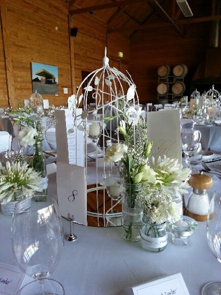Bird cage used as candle holder and wedding table centerpieces, wedding ideas modern, wedding reception venue at Frogmore Creek Wines