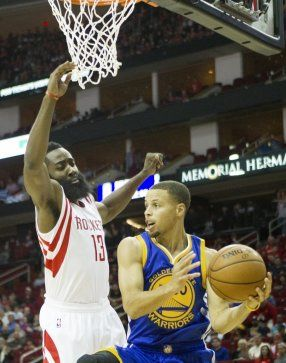 Houston Rockets guard James Harden defends Golden State Warriors guard Stephen Curry during the first half of an NBA game at the Toyota Center Saturday, Nov. 8, 2014, in Houston. (Cody Duty / Houston Chronicle)