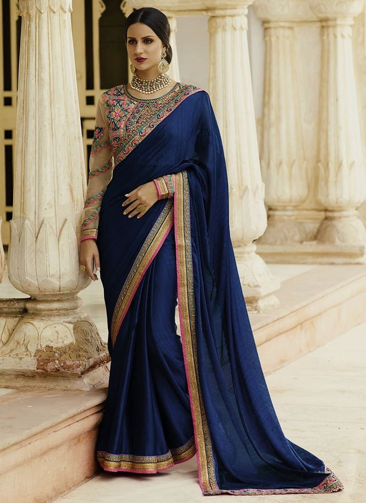 Online saree shopping from an exclusive collection of designer sarees. Buy this jacquard embroidered and patch border work classic designer saree for festival, party and wedding.