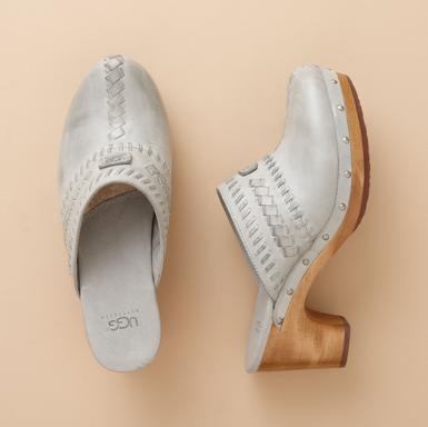 """Deft whipstitching and sheepskin-lined forefoot make these clogs something you'll want to slip into on a daily basis. Imported. 2-1/2"""" wood-wrapped rubber heel. Whole sizes 6 to 11."""