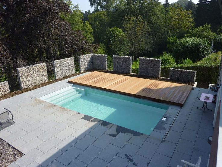 Sliding deck to cover pool when not in use! Perfect