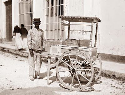 It was taken in Cuba, and shows a man selling ice cream from a cart on the side ...1900