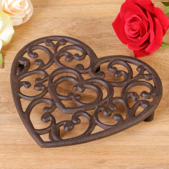 Give a gift they will love with this traditional 6th wedding anniversary iron kitchen trivet. Made from high quality durable cast iron this heart shaped trivet is perfect for protecting the dining table top and kitchen work top surface. A very decorative yet practical kitchen accessory this trivet features a traditional floral heart design and would look at home in any kitchen. This cast iron trivet pan holder is ideal for stopping hot pans from causing heat damage to surfaces while cooking.