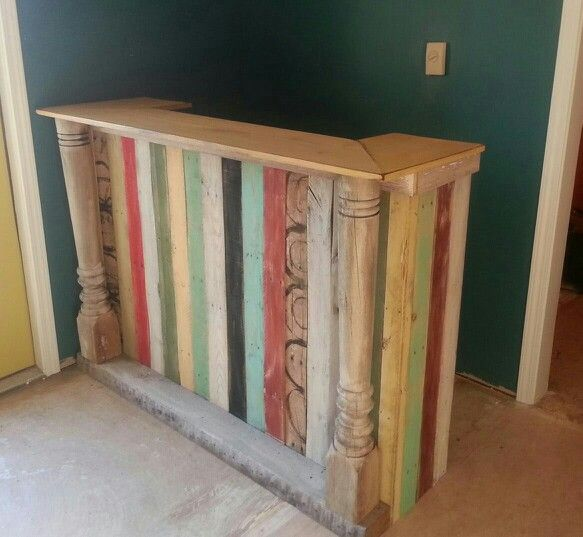 Reception counter made of pallet and reclaimed lumber. The salvaged porch post were a great touch.