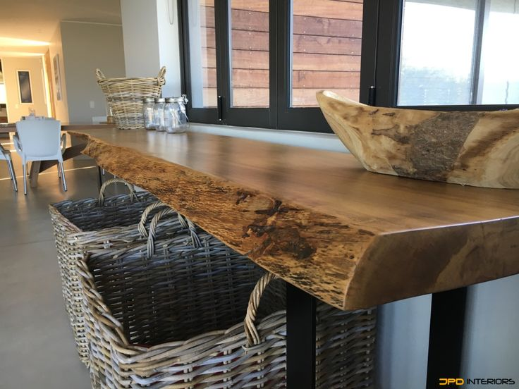 Server from with live edge timber, treated and sealed with steel legs.
