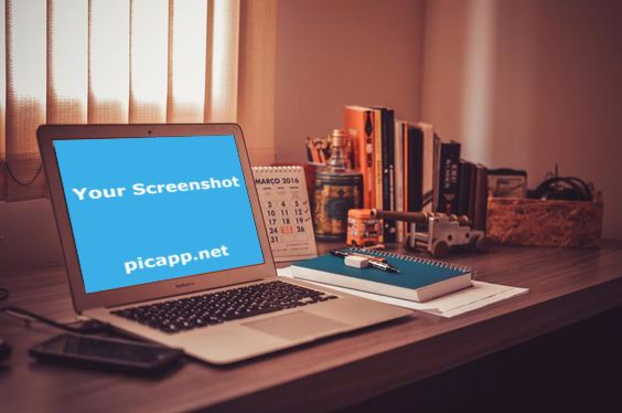 MacBook laptop on a crowded wooden desk next to an iPhone, notebook, pens, calendar and many books. Customize this image with your own app on PicApp.net - easy & free. #Macbook #iPhone #desk