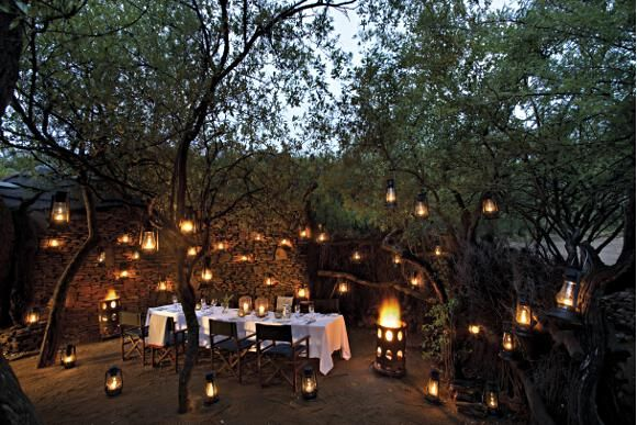 Alfresco dining by lantern-light at Madikwe Safari Lodge in Madikwe Game Reserve - underneath African skies studded with stars.