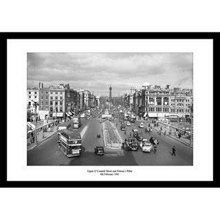 4th February 1961. A typical Saturday in Dublin as cars and bicycles vie with pedestrians and buses on O'Connell Street and Bridge – same as today without Nelson's column!