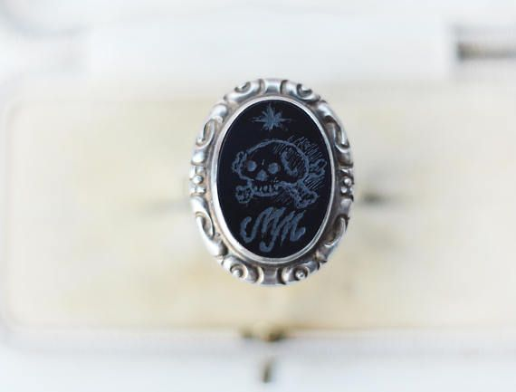 This is a boho Victorian style sterling silver ring with oval onyx that I engraved with antique memento mori motif: skull and cross bones, lucky star and MM for memento mori.  I think the ring was made in the last century, probably in Russia, but in the Victorian style. It is marked for