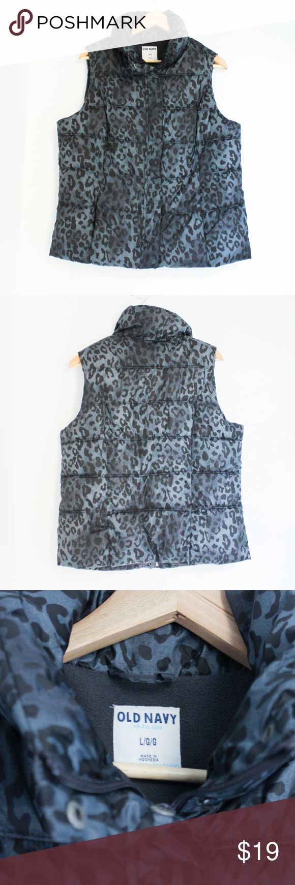 """OLD NAVY Leopard Print Fleece Puffer Vest Sz L OLD NAVY Women's Gray Black Zip Button Leopard Print Puffer Vest Sz L  This vest has a nice animal print on the shell. It zips all the way up as well as buttons/snaps. Fleece lined and has 2 pockets.   Approximate measurements: Length from shoulder to hem 24"""", Armpit to armpit 21"""" Old Navy Jackets & Coats Vests"""