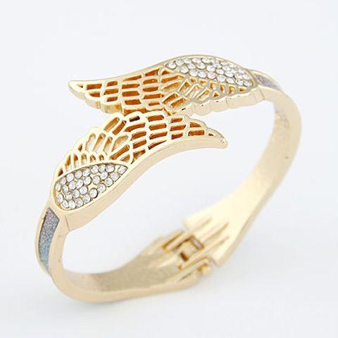 Angelical brazalete con detalle de alas y bordes dorados. $5.990 + gastos de envío. Envios a todo Chile vía Chilexpress. VENDIDA