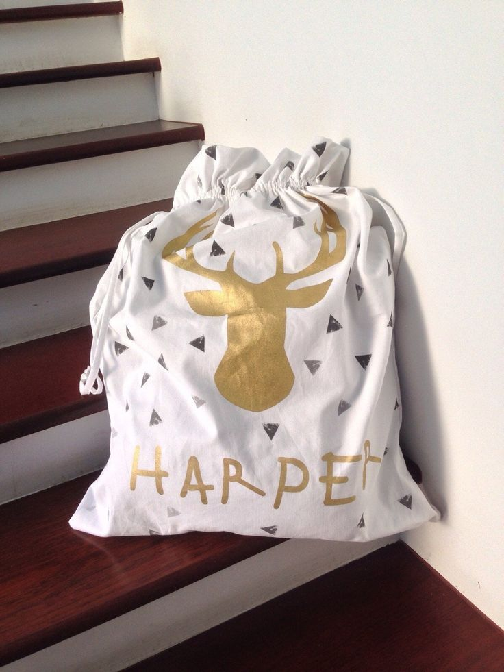 Gold Deer Head Personalised Santa Sack! Our beautifully designed and made Personalised Santa Sacks complete your Christmas Day! With 5 different designs and colour-ways, these Santa Sacks can be personalised with any name! Made from 100% thick cotton twill, finished with a corded drawstring.   The sunny+finn sack is HUGE at 75cm high x 60cm wide, much bigger than any others market! Have a sunny+finn Christmas with our trendy Christmas Clothing for little ones and Personalised Santa Sacks!