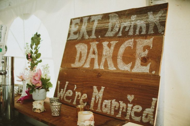 Painted text on wooden palette's will complement a rustic wedding theme! | Ways to Use Love Quotes For Weddings