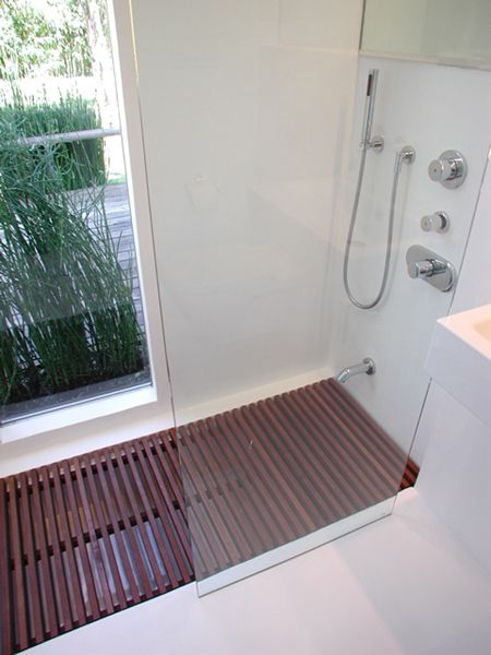 that looks like an in ground bathtub with a wooden mat turning it into a shower... what a great idea!!