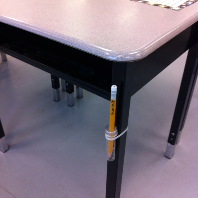 "Pencil Holster:  Made from flower water tubes (from florist) and a plastic tie (hardware store) to fasten it to desks. Label pencils with students' names so they don't lose them; this one is a special triangle pencil that won't roll off desks. Hopefully this solves the ""I can't find my pencil"" problem."