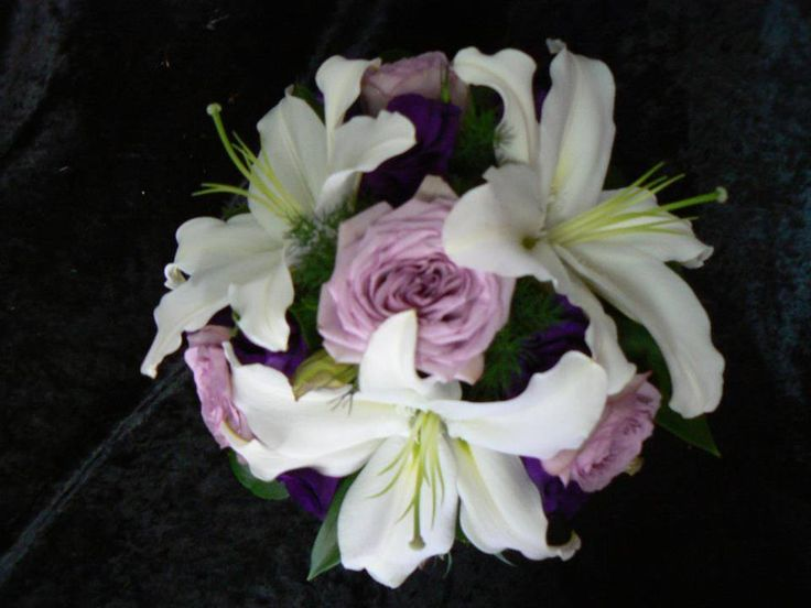 Mauve roses mixed with white oriental lilies & dark purple lisiathus