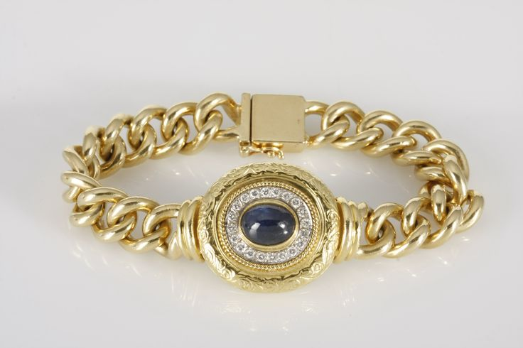A SAPPHIRE AND DIAMOND BRACELET, JENNA CLIFFORD  centred with a bezel-set cabochon-cut sapphire weighing approximately 4,70cts, highlighted by twenty round brilliant-cut diamonds weighing approximately 0,42cts in total, surrounded by an antique engraved rim, on an 18ct gold curb-link chain, in 18ct yellow and white gold. total gold weight 87.1g