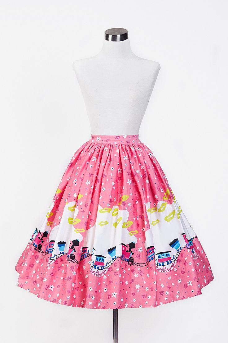 Pinup Couture Jenny Skirt in Mary Blair Pink Train Border Print