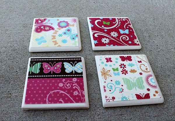 Cute DIY coasters! $0.13 per tile @ Home Depot.  Scrapbook paper, Mod Podge, Vinyl Bumpers (not felt!) for backing and polyurethane spray sealant.