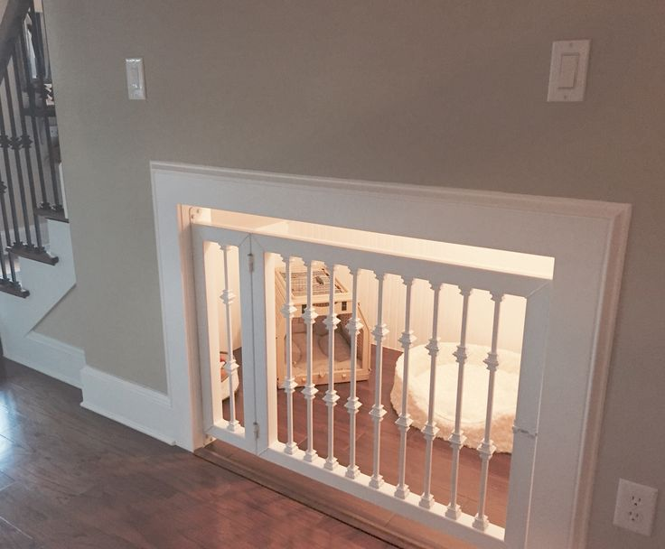 Attractive--and functional--dog kennel built under the stairs.