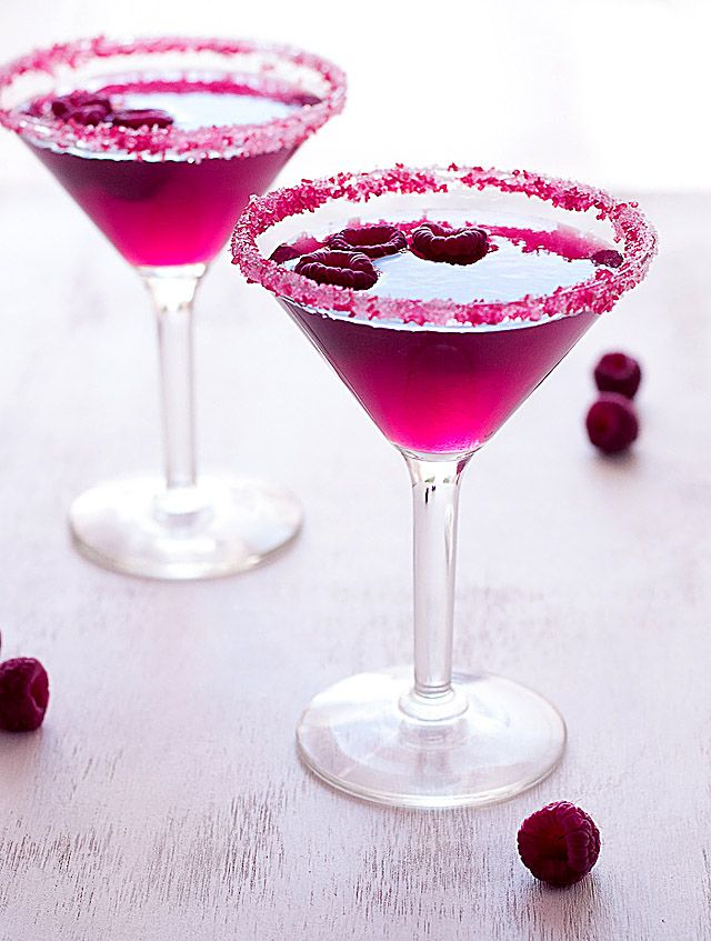 Very Pink Raspberry Cosmopolitan       2 oz Raspberry juice   2 oz Raspberry Liqueur  4 oz vodka  Juice from ½ lime  1 oz simple syrup  Pink sugar crystals  Raspberries for garnish)