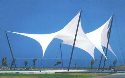 Tensioned fabric structure. This technology could be used to create shade and dynamic shapes between the lamp poles.