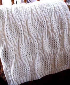 Free Knitting Pattern for Cabled Eyelet Baby Blanket - Love this pattern with alternating cables and eyelet sections. Designed by Nancy Hearne Pictured project by KathyL