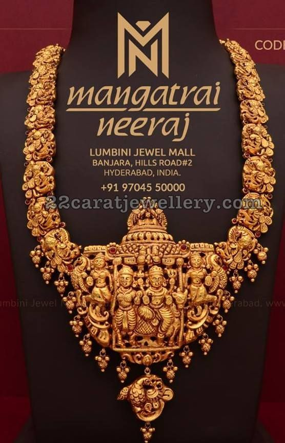 22 carat gold nakshi work Peacock embellished temple jewellery. Peacock and god pendant attached in the center. Small gold balls and nakshi balls hanging across the bottom. #GoldJewellery22Carat #GoldJewelleryTemple