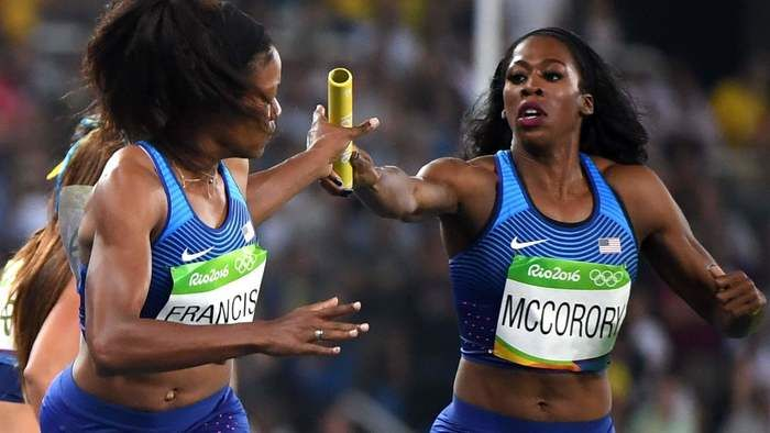 """GOLDEN! Hampton University star Francena McCorory handing off to Phyllis Francis in SFs Heat of 4X400M:  """"It doesn't matter who we run, we have some great girls & we all know we can get the job done & keep that streak going.""""  Francena said this after her American teammates breezed to a decisive 3-min, 21.42-s victory to ADVANCE to GOLD Medal FINAL Race at Estadio Olimpico. Team USA won GOLD in that FINAL! 8/19/16 Rio 2016"""