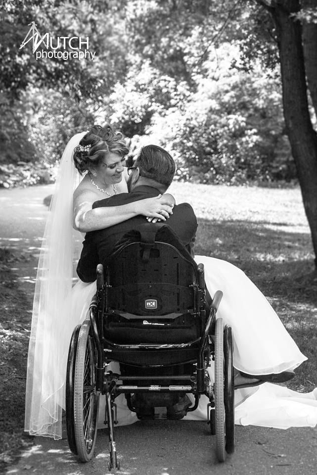 Wheelchair wedding photography. >>> See it. Believe it. Do it. Watch thousands of spinal cord injury videos at SPINALpedia.com