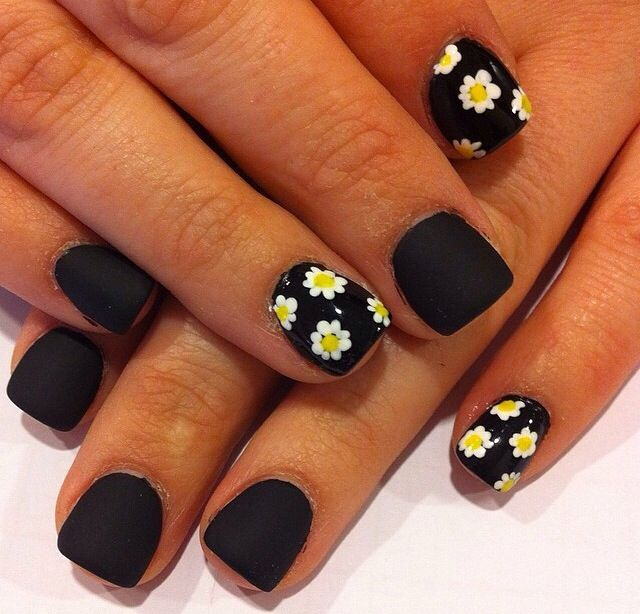 Black matte nails with Daisy's