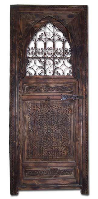 Filigree wrought iron cedar door - justmorocco doors. Amazing Moroccan door. Entry-way.