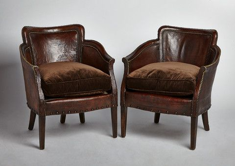 A pair of exquisite 1920's French leather and hobnail armchairs.