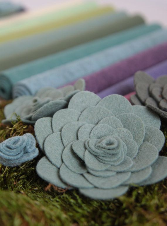 Wool blend felt in the colors of succulents: Ecru, Pistachio, Fern, Sage, Olive, Blue Spruce, Rainstorm, Vineyard, Violet and Mulberry, ten sheets of wool blend felt in all. Select 9x12 or 12x18 sheets from our drop down menu. Coordinating DMC floss is also available. To make your own felt succulents view Benzies diy here: http://benziedesign.com/blogs/tutorials/115305860-felt-succulent-diy  { About Benzies felt } Wool felt is one of the most versatile and beautiful fabrics to create with, a…