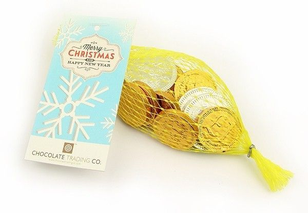 Net of Christmas sterling chocolate coins 25g by Chocolate Trading Co.  A net of chocolate coins in sterling and containing gold £1, Silver 5p and Silver 10p. Complete with a Merry Christmas & Happy New Year gift tag. Perfect for Christmas stocking fillers and promotional gifts. • Personalise these nets of foiled chocolates with a full colour printed label with your logo and message.  • Minimum order quantity for personalised labels x100 nets. Please call or email for further information.