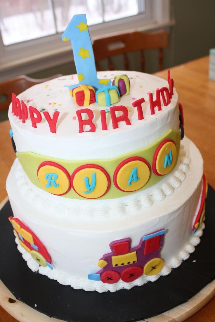 - car, plane, train birthday cake, tfl