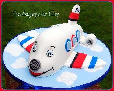 Cutesie Airplane Birthday Cake... I'm thinking it's Jay Jay the Jet Plane.