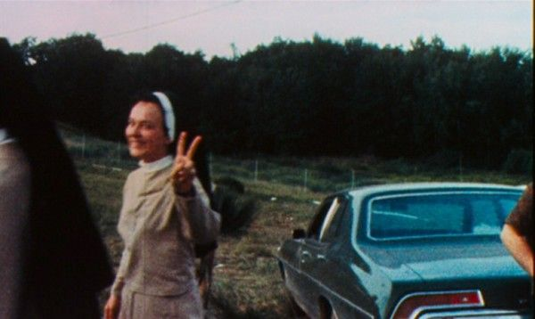 A nun flashing a peace sign at Woodstock, 1969.....Not kidding (not the clearest picture, but I like it for what it is and the timing)
