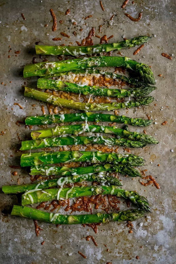The Best Oven Roasted Parmesan Asparagus Recipe - delicious garlic and parmesan packed asparagus that is super simple and a perfect side dish that is bursting with flavor, low carb and perfect for keto diets, and always a crowd favorite!