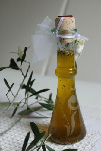 BOMBONIERA - Condimento aromatico a base di olio extravergine d'oliva con incisione personalizzabile sul vetro della bottiglia.