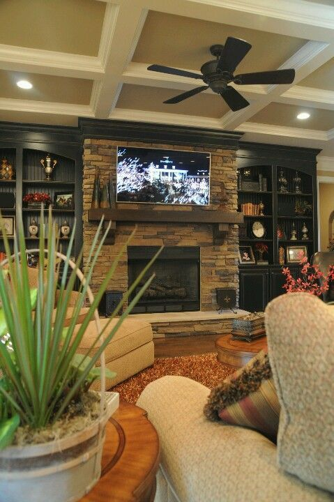 Living room, built in cabinets, stone fireplace, CENTERED tv.... Hate when ppl put it on the side of the fireplace, just looks awkward.